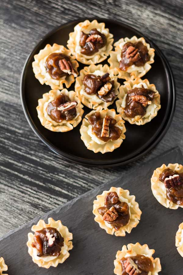 Cheese Tart with Dried Fruit Chutney recipe is the perfect appetizer for any occasion. Dried Fruit Chutney over cheese with chopped, toasted pecans sprinkled over each. Find the Dried Fruit Chutney and more recipes at Spoonabilities.com