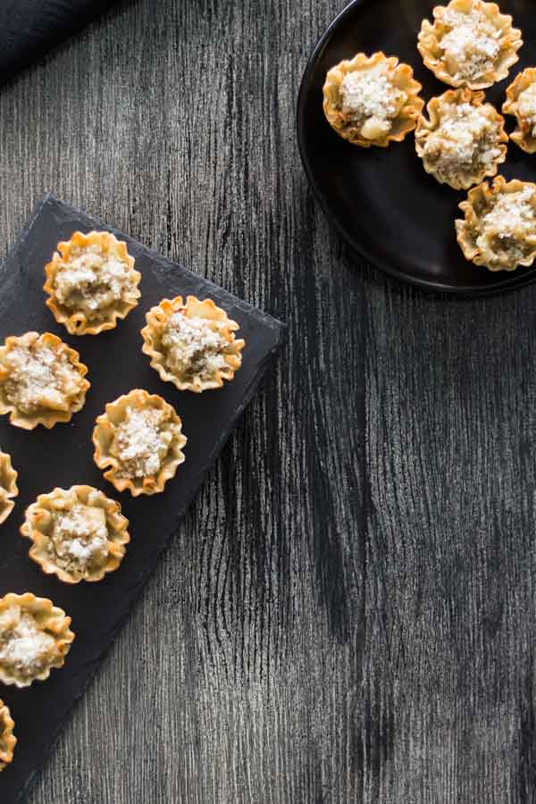 Artichoke Parmesan Bites is our collection of recipes easy 1-2-3. This is a perfect bite with the crunchy shell, Artichoke Parmesan Tapenade, and the melted shared Parmesan. Find this recipe and more party ideas at Spoonabilities.com