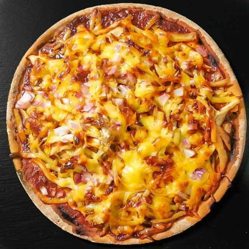 Easy BBQ Chicken Pizza Recipe was made our Spicy Orange BBQ Sauce. The Pizza is citrus, tangy, spicy and of course with strong BBQ flavor. Find this recipe and the BBQ Sauce at Spoonabilities.