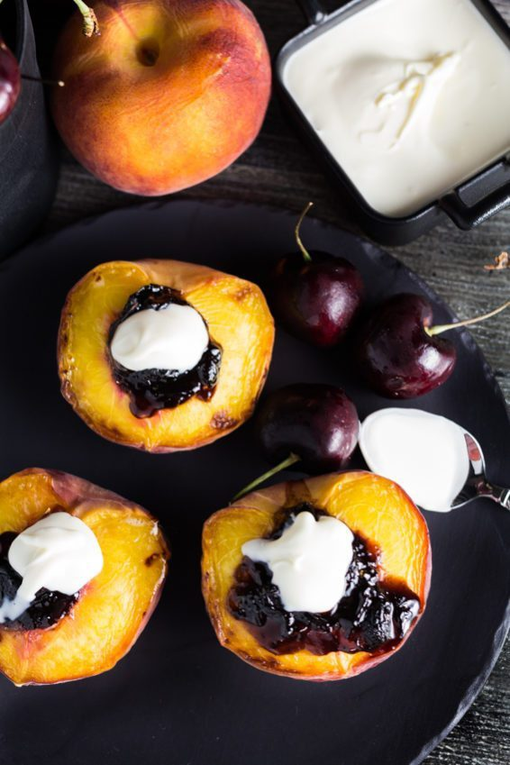 Fresh Broiled Peaches with the delicious Black Cherry Preserve & topped with a creamy Creme Fraiche. You can find this recipe and others fresh and super easy recipes at Spoonabilities.com