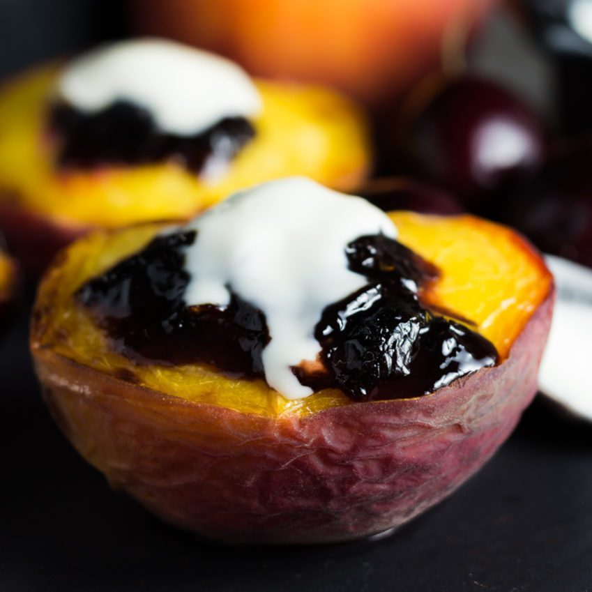 Broiled Peaches with Black Cherry Preserve topped with a creamy Creme Fraiche. You can find this recipe and others fresh and super easy recipes at Spoonabilities.com