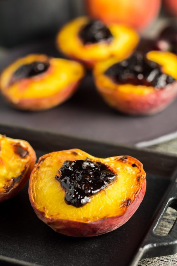 Fresh Broiled Peaches with delicious Black Cherry Preserve & topped with a creamy Creme Fraiche. You can find this recipe and others fresh and super easy recipes at Spoonabilities.com