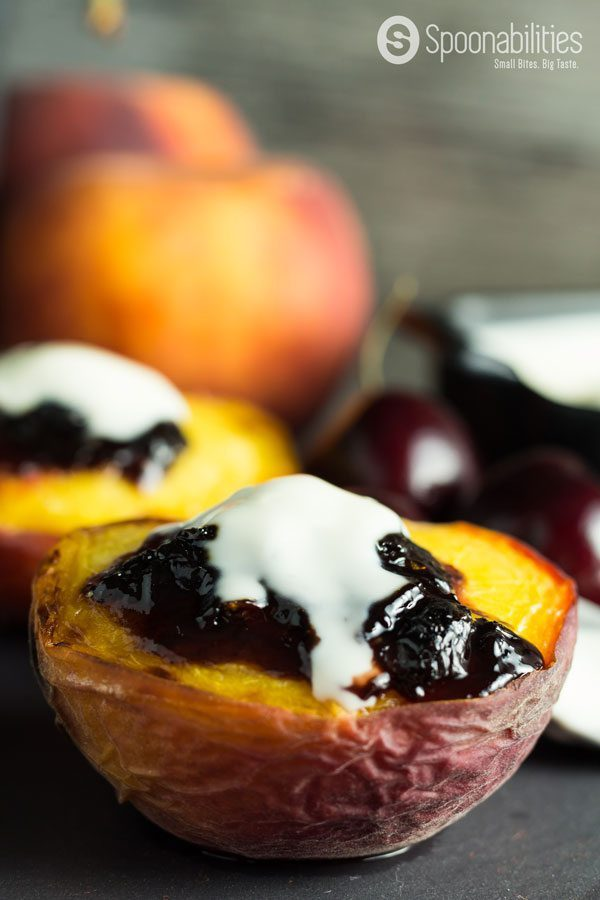 Stone Fruit Season Broiled Peaches with Spiced Sour Cherry Spread. Very easy and quick recipe for any day of the week as a light dessert or as appetizer dessert. Find this recipe and more at Spoonabilities.com