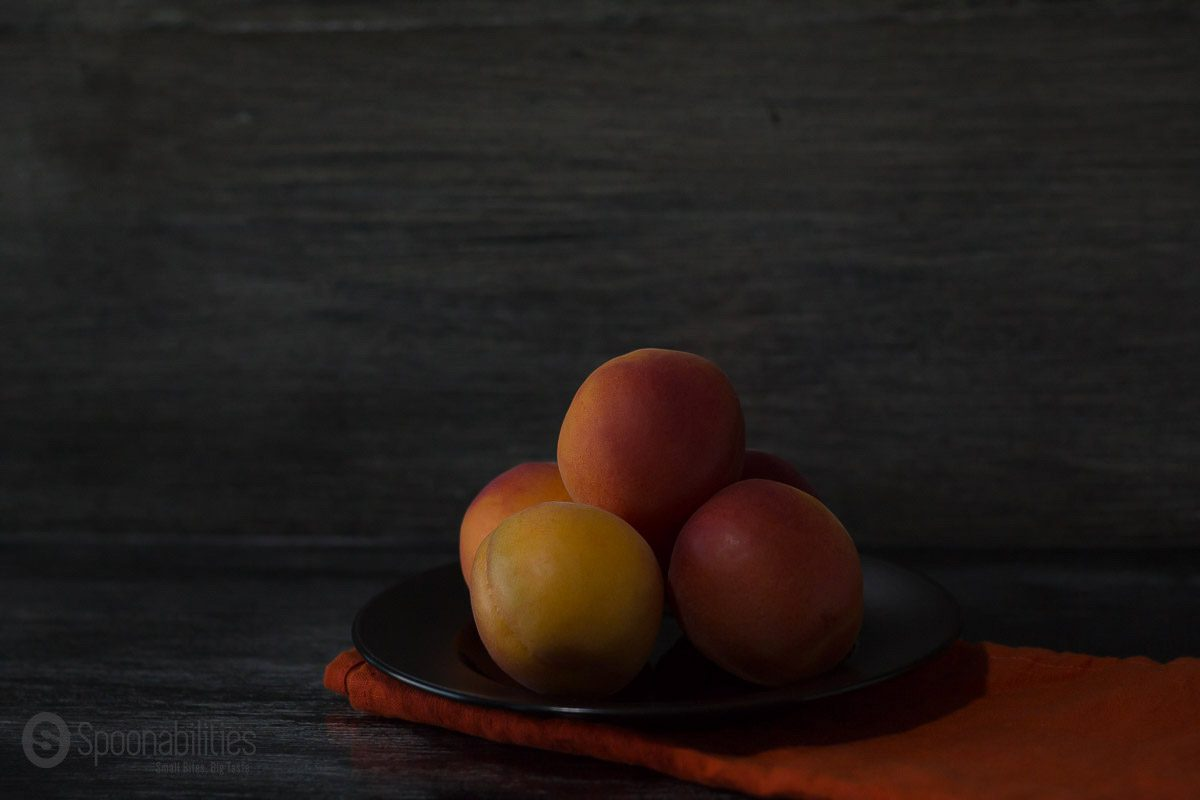 Stone Fruits five Peaches on a plate dark background artistic. Taken by Carlos Leo at Spoonabilities.com