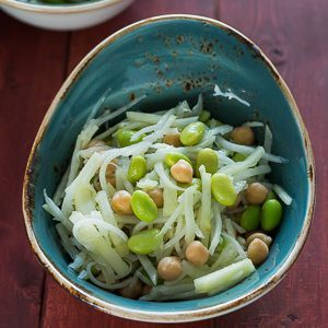 Kohlrabi Salad with Edamame, Chickpeas, and Apple is a refreshing and crunchy salad with a lemony & herby dressing, using Cilantro Cottonseed oil. Spoonabilities.com