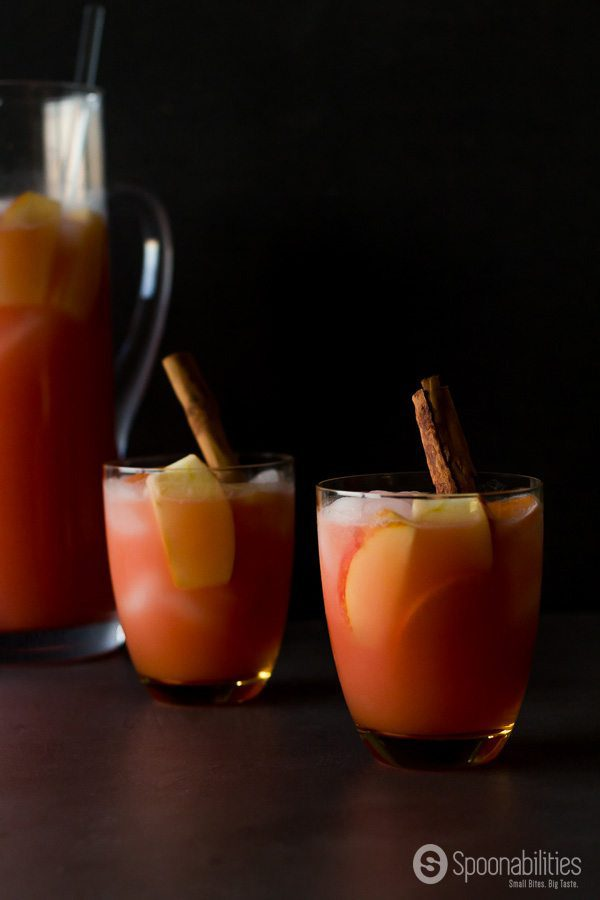 Caramel Apple Cider Vodka Punch recipe has apple cider, vodka, grenadine, lemon juice, caramel sauce and some sliced Ambrosia Apple & Persimmon. Spoonabilities.com