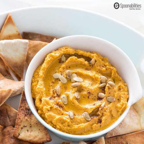 Pumpkin Hummus is the perfect appetizer recipe for Fall holiday parties. Easy to make. Made of chickpeas, Pumpkin Puree, Tahini, Garlic, Parsley & Greek EVOO. Pumpkin hummus is a great appetizer option for your Thanksgiving dinner. Spoonabilities.com