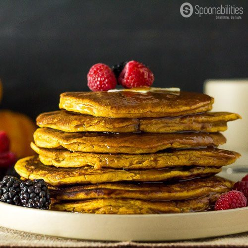 Spiced Pumpkin Pancake recipe is the perfect breakfast for this cozy Fall/Autumn season. Homemade Pumpkin Spice Pancake Mix, milk, egg, pumpkin puree, vanilla and vegetable oil. I used my favorite Pumpkin Spice Syrup, which is made with real pumpkin. Spoonabilities.com