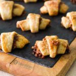 Easy Rugelach cookie with a sweet cream cheese dough is crumbly and filled with a mix of nuts, sugar, cinnamon and with Fig Jam. Available at Spoonabilities.com