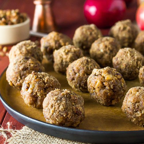 Mini Caramel Apples has four ingredients and easy to make for a tasty holiday treat for kids or adults. With apples, pecan, cinnamon, and Salted Caramel Sauce available at Spoonabilities.com