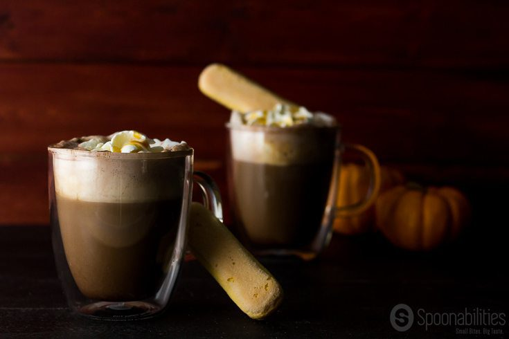 Two clear mugs of Pumpkin Spiced Mocha with two lady fingers