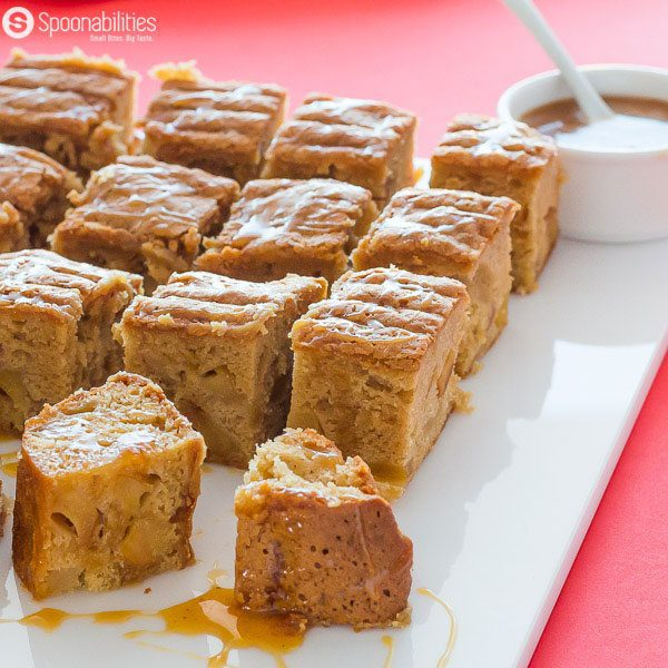 Salted Caramel Apple Blondies are spongy and serious on the butter with chunks of apples simmered in a caramel sauce by Coop's. Available at Spoonabilities.com