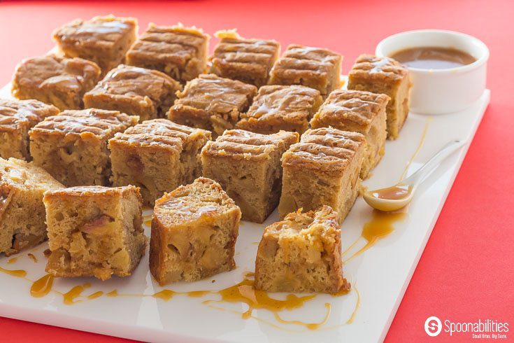 Salted Caramel Apple Blondies with apples simmered in Salted Caramel Sauce are gooey, moist, and addictive. Featuring our handmade Salted Caramel Sauce by Coop's. Available at Spoonabilities.com