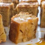 Tight closeup of one Caramel Apple Blondies Brownies simmered in Caramel Sauce available at Spoonabilities.com