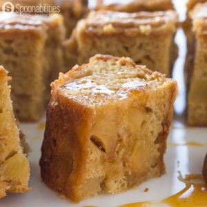 Salted Caramel Apple Blondies are gooey, chewy, moist, and addictive dessert with pieces of apples that have been simmered in Salted Caramel Sauce available at Spoonabilities.com