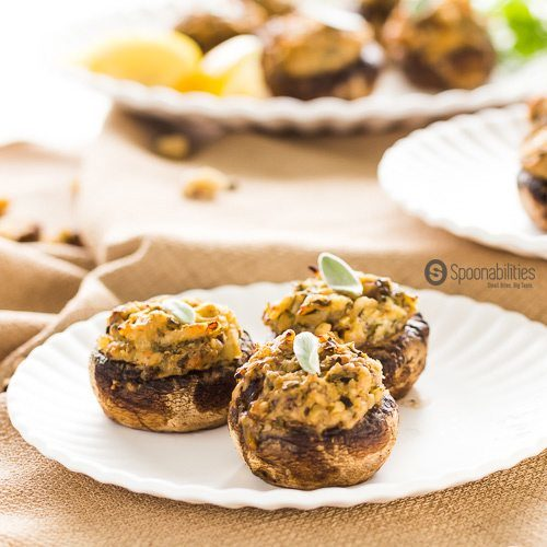 Easy Artichoke Lemon Pesto Stuffed Mushrooms. Quick and easy appetizer for your next party. Italian-Mediterranean inspired appetizer recipe with Artichoke Lemon Pesto by Elki. Available at Spoonabilities.com