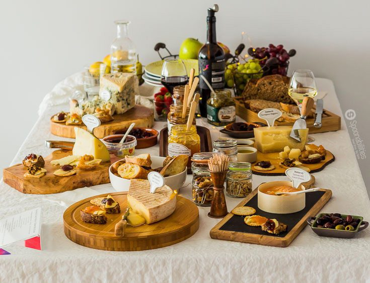 Wine and Cheese Tasting Party with Jams & Tapenade, Pairing ideas. Each Cheese presented in individual wooden boards. Chic & Rustic Tasting Table display. Spoonabilities.com
