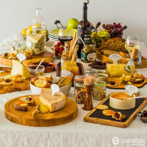 Wine and Cheese Tasting Party with L'Epicurien Apricot Preserve, Black Olive Tapenade. Cheese and jam pairing in beautiful rustic wooden boards. Spoonabilities.com