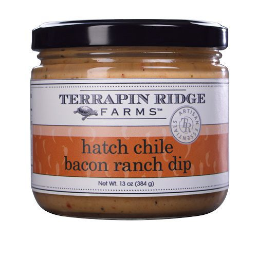 Hatch Chile Bacon Ranch Dip is insanely delicious dip has Hatch Chile peppers, bacon, roasted red pepper puree, and all this mixed with a creamy ranch produce a crazily tasty dip. From Terrapin Ridge Farms. Available at Spoonabilities.com