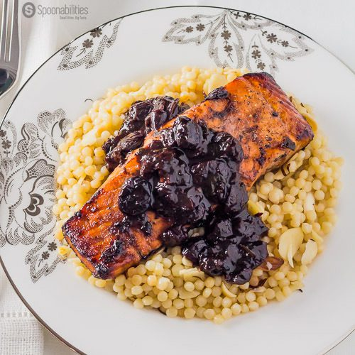 Recipe for Chipotle Cherry Sauce over Broiled Salmon on a bed of Lemony Israeli Couscous, featuring Black Cherry Jam, available at spoonabilities.com