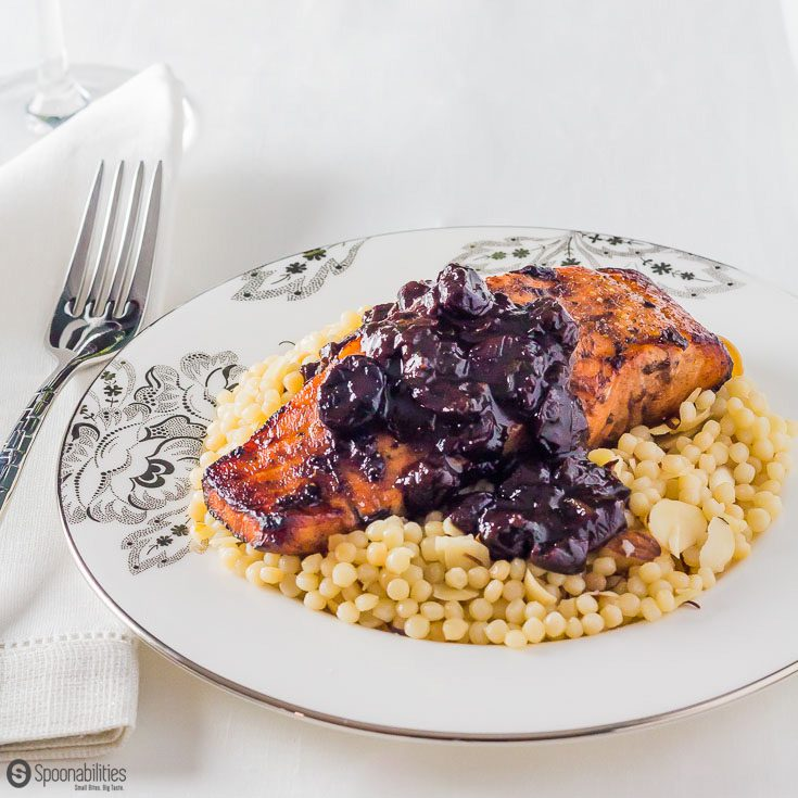 Spiced Sour Cherry Spread is the main ingredient in this Chipotle Cherry Sauce recipe over Broiled Salmon with Israeli Couscous. spoonabilities.com