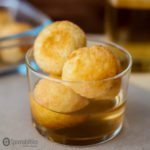 Immigrant Food Story about Fried Dough Balls recipe - my Dominican dessert recipe Buñuelos usually served during Easter week. Spoonabilities.com