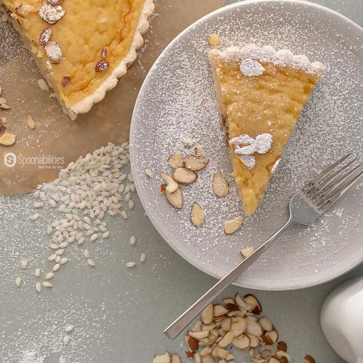 The Traditional Swiss Easter Rice Tart Recipe is a crunchy sweet tart filled with a custard type filling of rice pudding, lemon, and ground almond. Spoonabilities.com