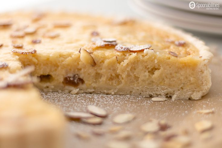 The Traditional Swiss Easter Rice Tart is a dessert recipe made in Switzerland during Easter with rice pudding, lemon, raisin, ground almond, and we added amaretto liquor. Spoonabilities.com