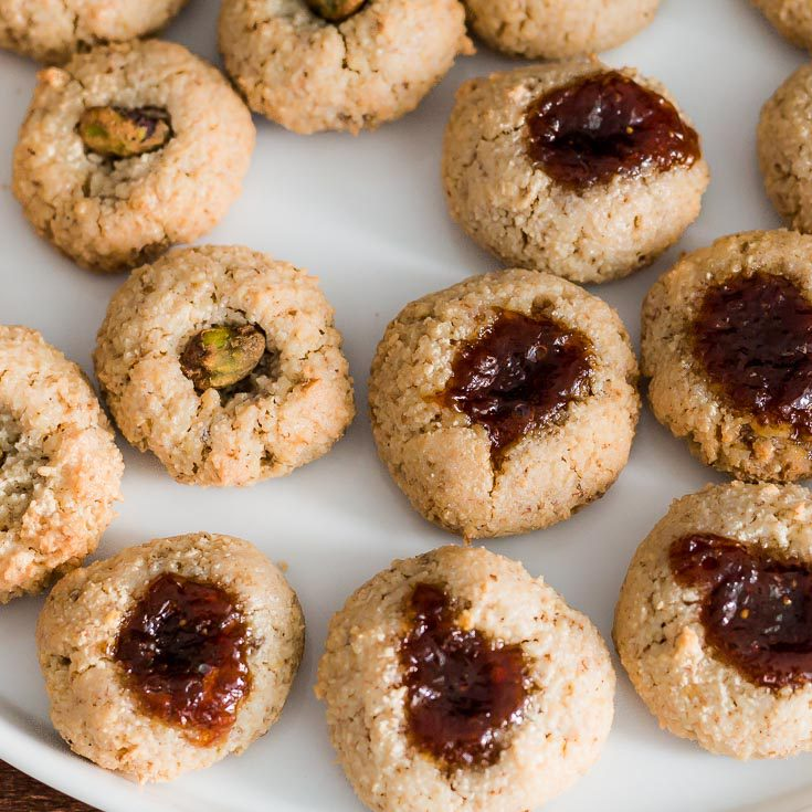 closeup place of Walnut Macaroon Thumbprint Cookies