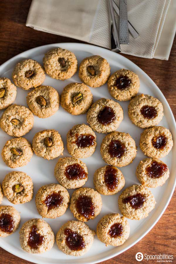Large round plate of Walnut Macaroon Thumbprint Cookies