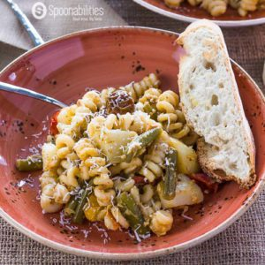 Artichoke Pesto Pasta Salad with with a piece of bread
