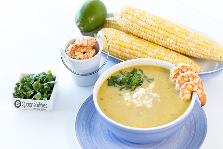 Creamy Hatch Green Chile Soup is a Tex-Mex inspired recipe packed full of flavors from Hatch Chile Pesto, fresh summer corn, coconut milk, and cilantro lime grilled shrimp.