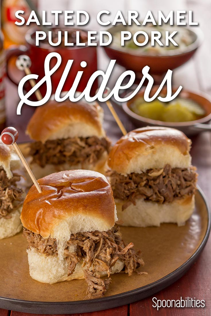 Four Salted Caramel Pulled pork sliders on a plate with condiments in the background. Spoonabilities.com