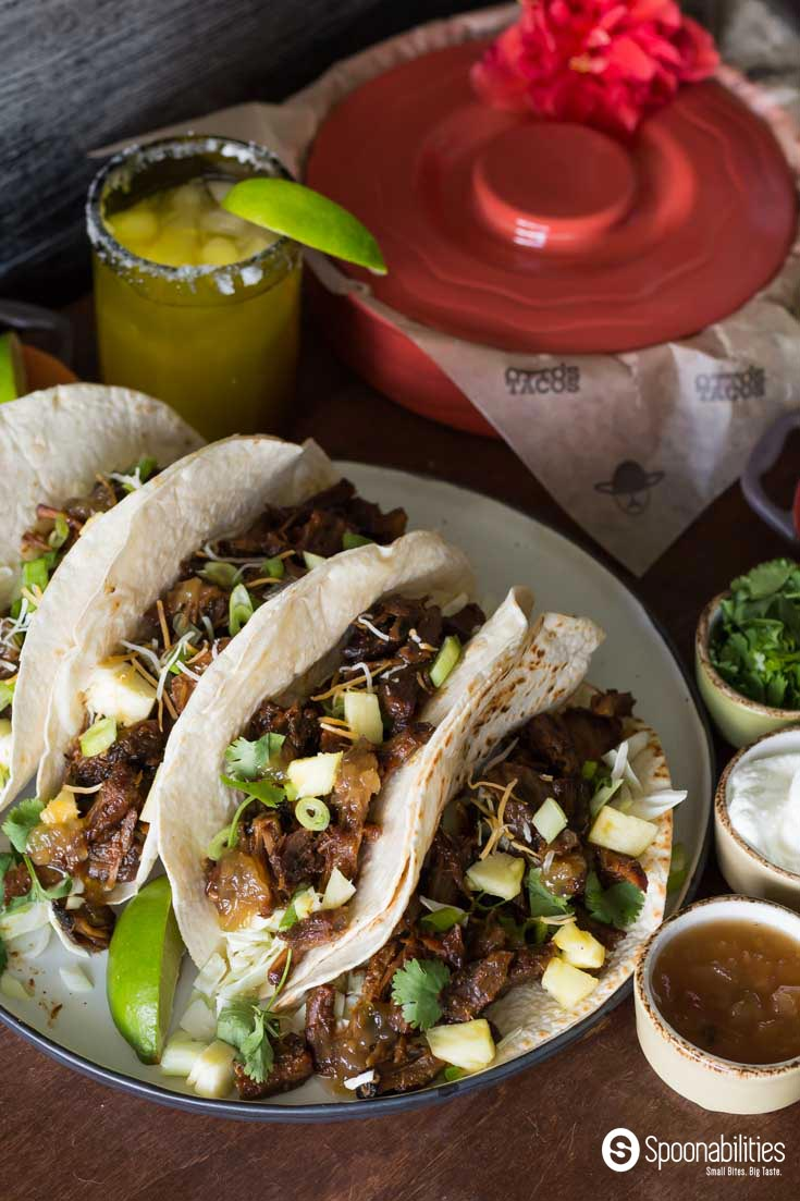 Pork Carnitas tacos with Roasted Pineapple Habanero Sauce. Perfect Mexican inspired dinner party or a taco night at home. Spoonabilities.com