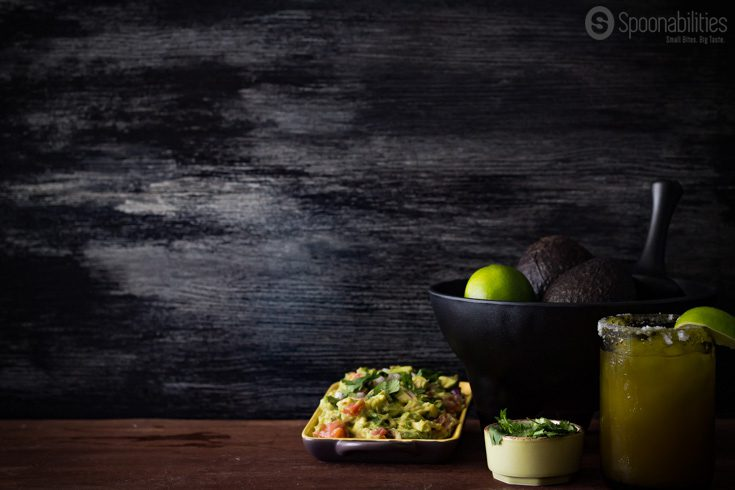 Beautiful background with guacamole, avocados, cilantro and a refreshing margarita. Used for the Pork Carnitas Tacos photo shoot session. Spoonabilities.com