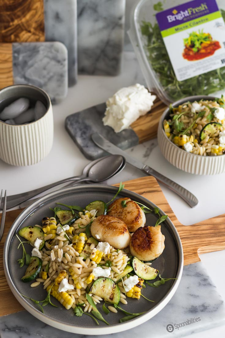 This Grilled Corn Zucchini Orzo Salad has a creamy texture and a tender and crunchy bite. Made with cilantro micro greens by Bright Fresh. Spoonabilities.com