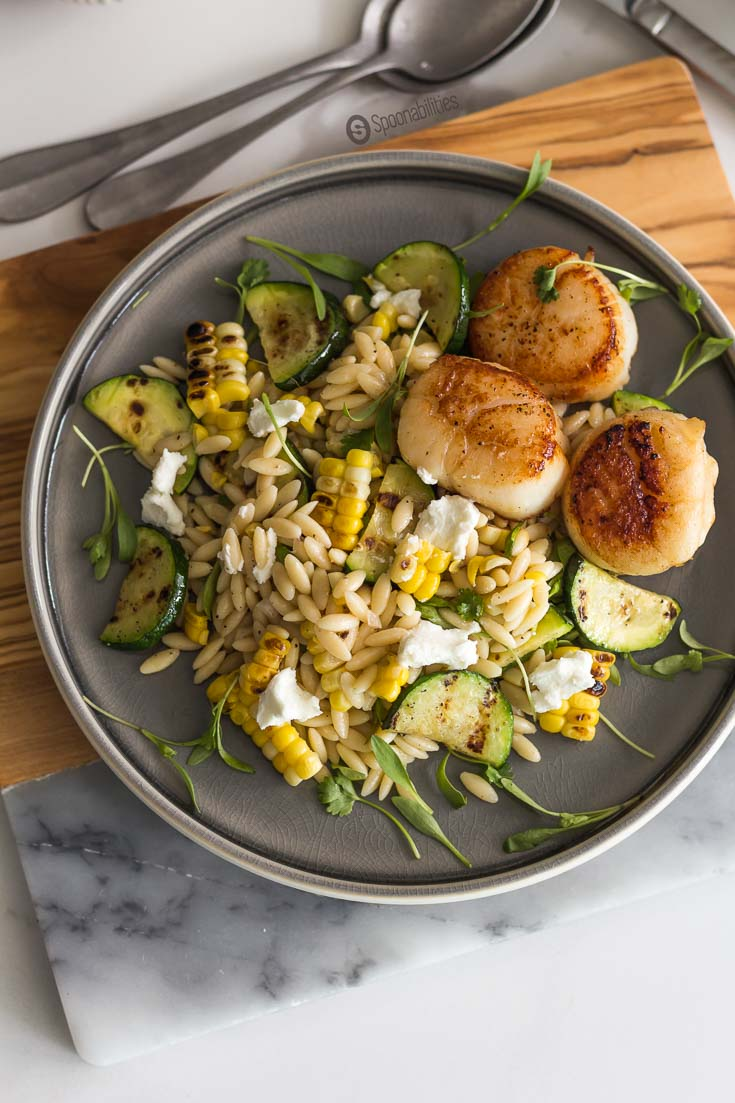 The Grilled Corn Zucchini Orzo Salad is one of the best salad recipes with an excellent texture and flavor for a perfect bite. Spoonabilities.com