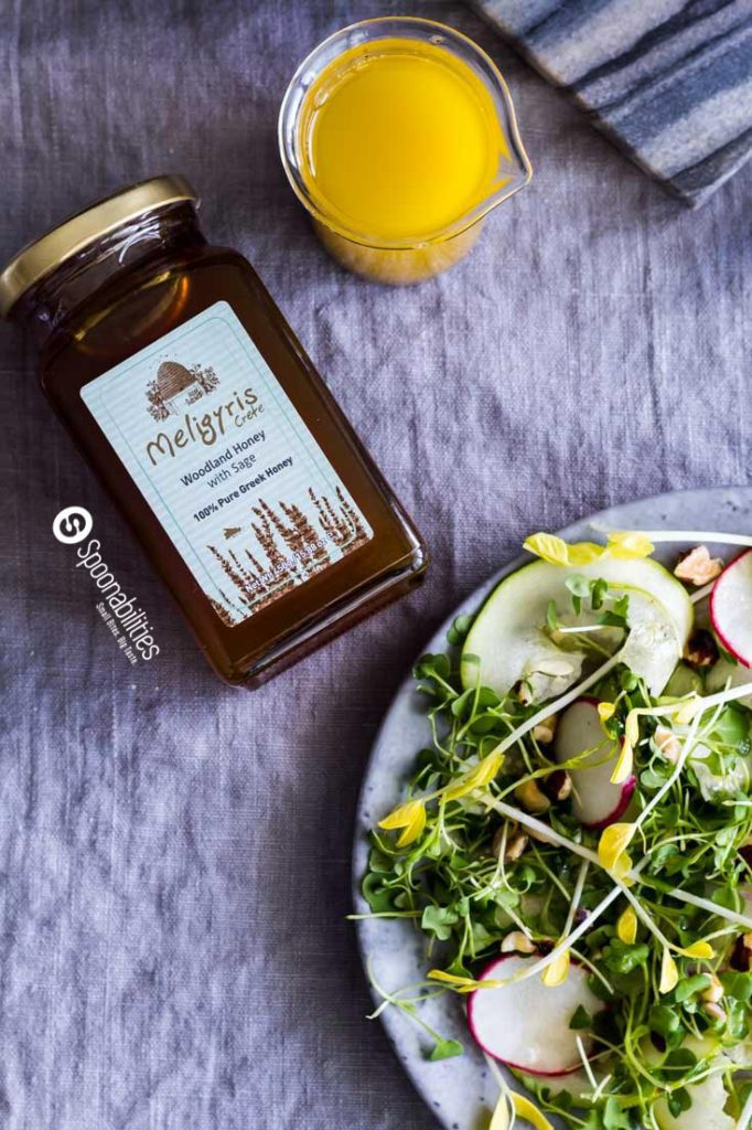 Meligyris Greek Honey with Wild Herbs & White Thyme is an important ingredient for this Champagne Mustard Vinaigrette on top of a delicious Pea Shoot Salad. Spoonabilities.com