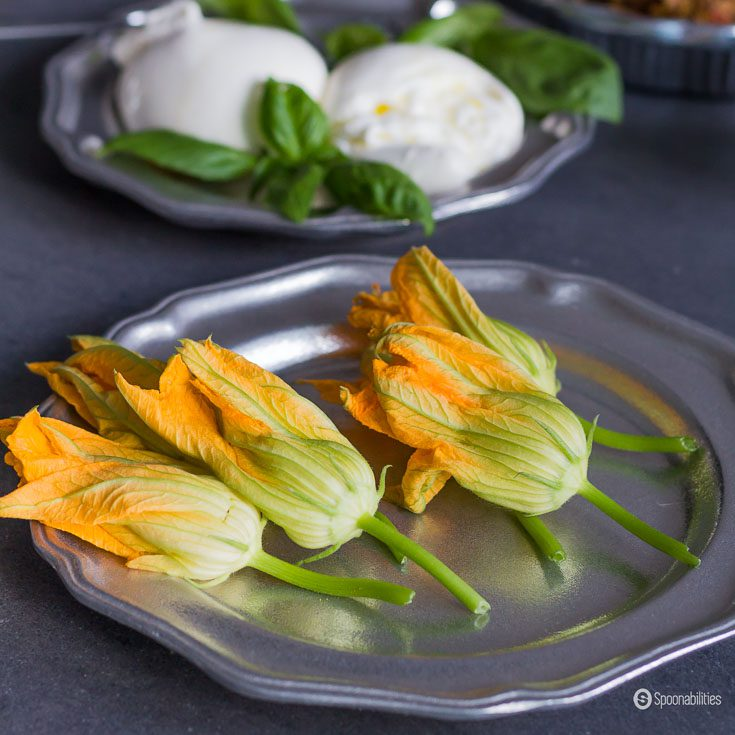 Fresh Stuffed Squash Blossoms in their raw state look beautiful on your table with the vibrant orange-yellow color of these edible flowers. Spoonabilities.com