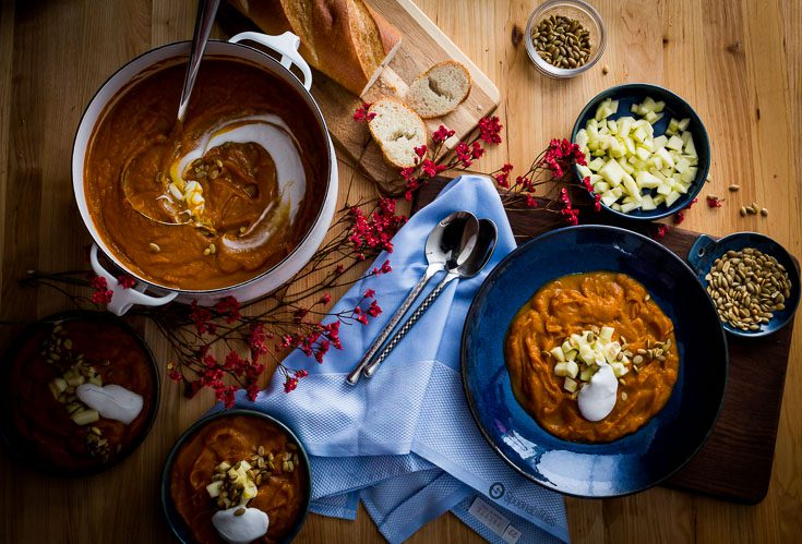 Roasted Pumpkin Bisque is cooked with apple juice, sautéed leeks, vegetable stock and vanilla. This fall soup recipe is perfect for Thanksgiving dinner. Spoonabilities.com