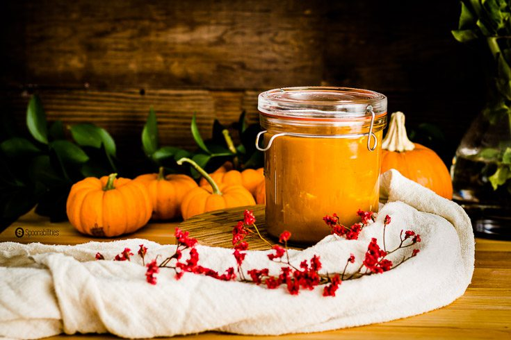 Roasted Pumpkin Bisque is cooked with apple juice, sautéed leeks, vegetable stock and vanilla. This fall soup recipe is perfect for Thanksgiving dinner. In glass container lock-eat by Luigi Bormioli. Spoonabilities.com