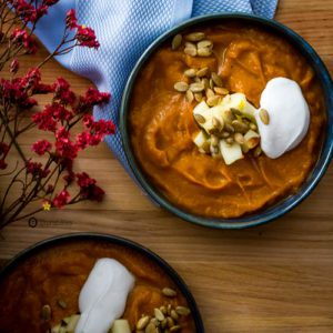 Roasted Pumpkin Bisque is a healthy vegetarian Fall comfort food recipe for any week night or Thanksgiving dinner. Dairy-free, Gluten-Free & Paleo soup recipe. Spoonabilities.com