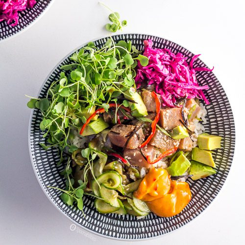 Homemade Spicy Tuna Poke Bowl Recipe is a refreshing and delicious #FishSalad made with rice, raw yellowfin tuna with a citrusy ponzu sauce, arugula & spicy mayo. Spoonabilities.com
