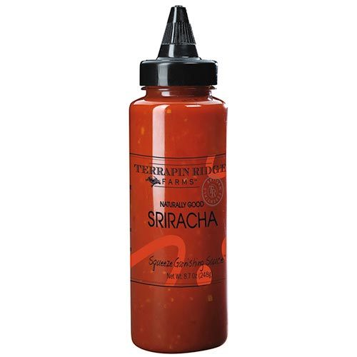 Sriracha Squeeze Garnishing Sauce by Terrapin Ridge Farms is a level above traditional Sriracha sauce. Great on sandwiches and eggs. Give a kick to your hummus and roasted vegetables. Gluten Free. Spoonabilities.com