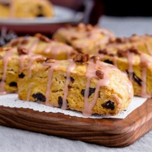 Cherry Pumpkin Scones are Fall inspired with blood orange & maple syrup glaze, garnished with maple roasted pumpkin seeds. Spoonabilities.com