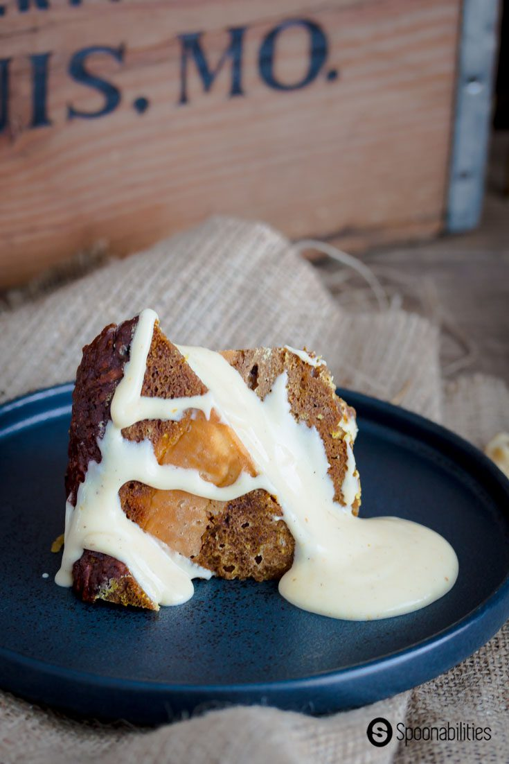 Pumpkin Carrot Bundt Cake is a dessert inspired by the autumn season. The Moist creamy rich carrot cake with pumpkin puree, pumpkin spice syrup & cream cheese. Great dessert for Thanksgiving. Spoonabilities.com