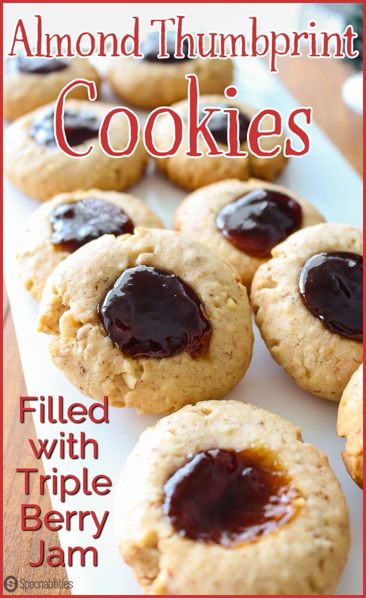 Almond Thumbprint Cookies filled with Triple Berry Jam. Much easier Christmas cookie recipe than past years. Delicious cookie filled with any flavor jam you love. #Christmas #ChristmasCookies #Cookies Spoonabilities.com