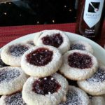 Almond Thumbprint Cookies filled with Triple Berry Jam. Christmas cookies so versatile that you can add your favorite jam to vary the flavors. #Christmas #ChristmasCookies #Cookies Spoonabilities.com