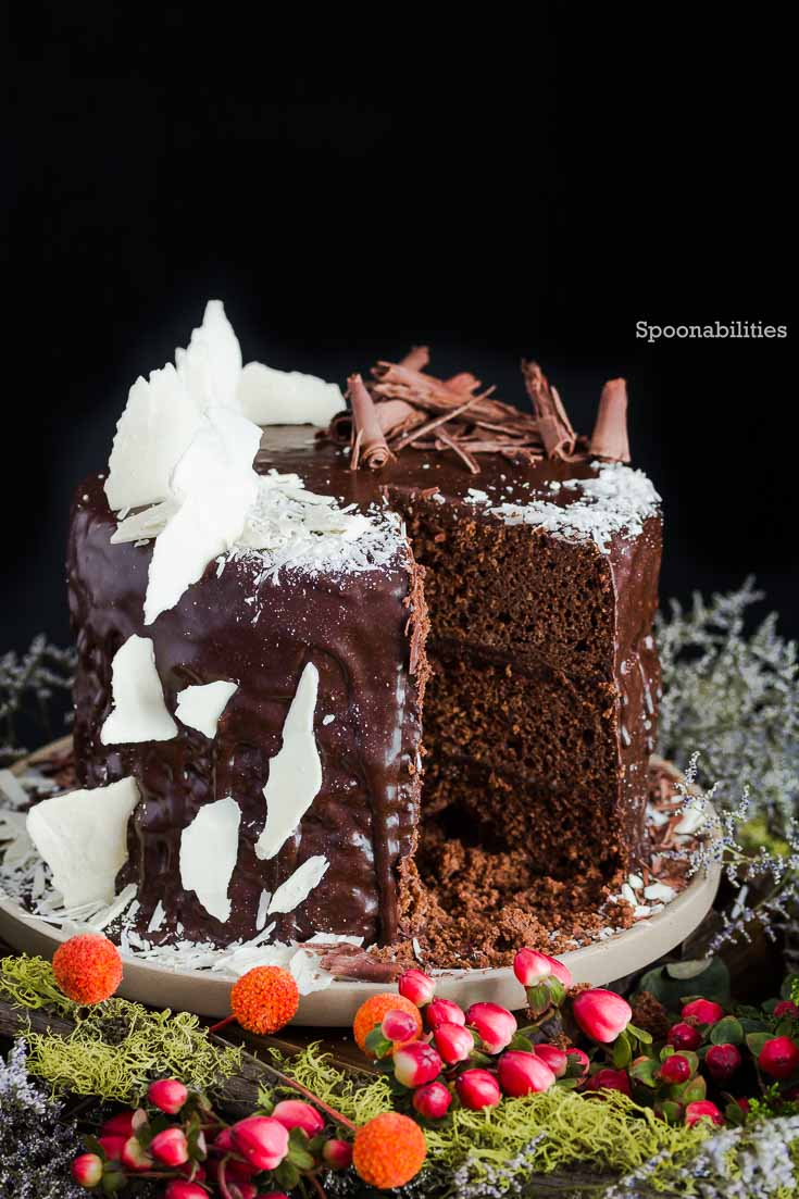Death by Chocolate cake with chocolate ganache. Decorated with semi-sweet chocolate curls and white chocolate shards. Spoonabilities.com