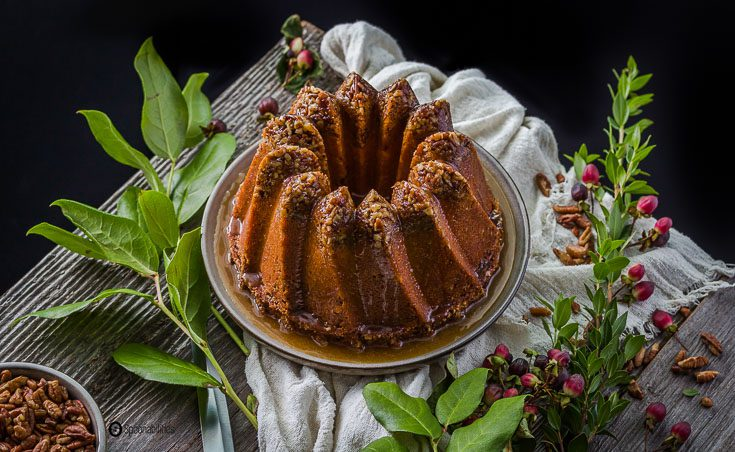 Pecan Pie Bundt Cake is a rich dessert. The Kugelhopf Bundt Pan gives a dramatic and distinctive angled cake, and allows the syrup to glide through the sweeping towers. Spoonabilities.com
